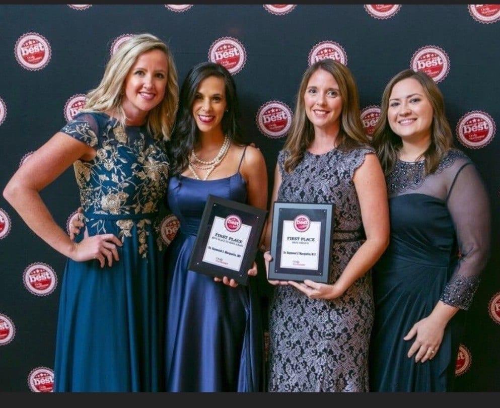 beautiful employees accepting an award